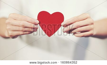 Woman hands holding Heart shape Love symbol holiday Valentines Day romantic greeting lifestyle feelings concept