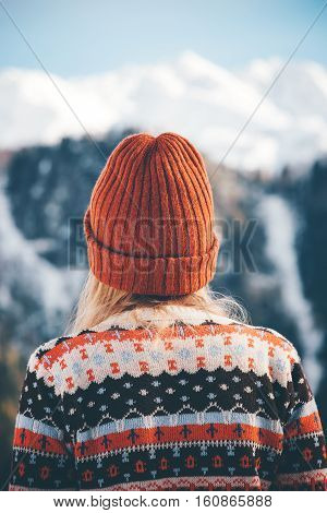 Woman traveling in mountains wearing cozy sweater and hat Travel Lifestyle adventure concept vacations into the wild
