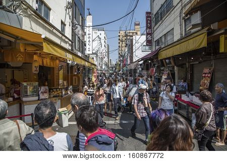 TOKYO, JAPAN - OCTOBER 2, 2016: Unidentified people at Tsukiji fish market in Tokyo Japan. Tsukiji is the biggest wholesale fish and seafood market in the world.