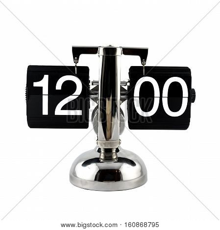 Isolated vintage flip clock at twelve o'clock on white background