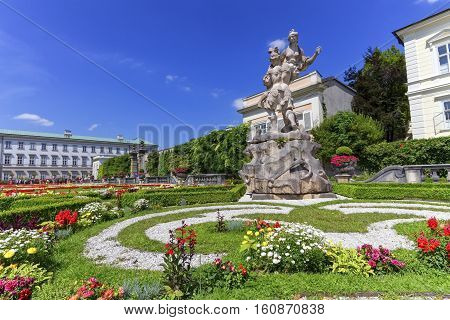 Mirabell palace and gardens with lots of flowers by day, Salzburg, Austria