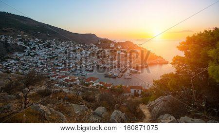 Hydra island in the setting sun, Aegean sea, Greece.