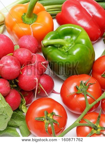 Fresh colorful vegetable mix on white background