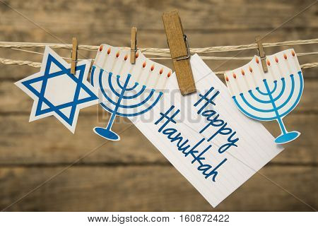 Happy Hanukkah greeting card or background. wooden background.