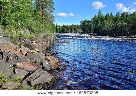 Threshold Padun on the river Chirko-Kem in summer sunny day. Karelia, Russia