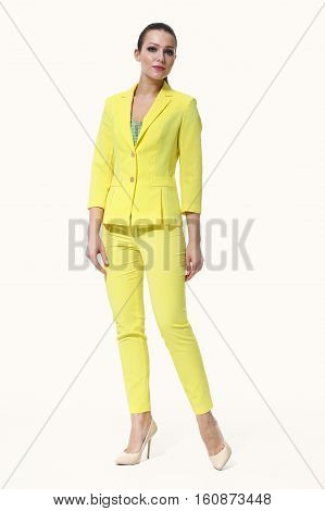 woman with straight hair style in casual yellow paint suit jacket black trousers full body photo high-heeled shoes isolated on white