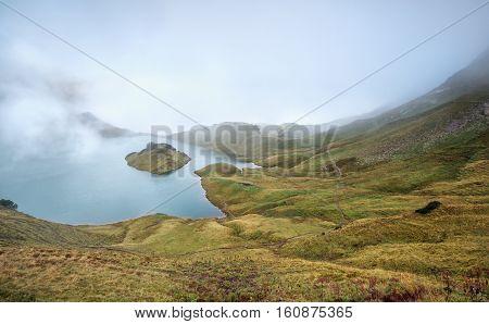 foggy morning on alpine lake Schrecksee Germany