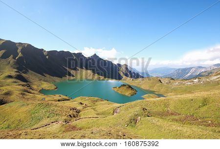 turquoise alpine lake in sunny day Bavaria Germany