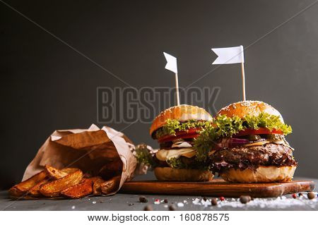 Two Mouth-watering, Delicious Homemade Burger Used To Chop Beef. On The Wooden Table.
