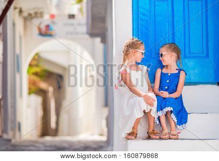 Girls in dresses having fun outdoors on Mykonos streets