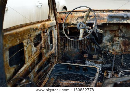Salon of the burnt car concept riots