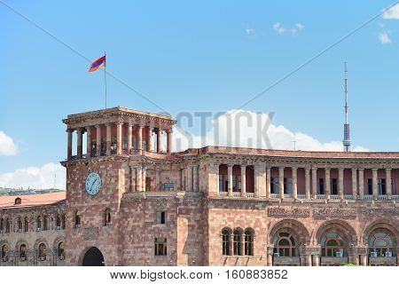YEREVAN ARMENIA - MAY 2016: a central square of the city of Yerevan in Armenia. State House and the national flag of Armenia.