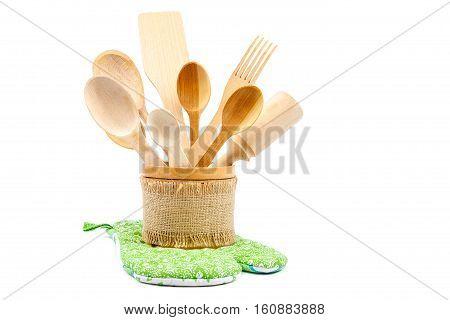 Set of wooden kitchen utensils isolated on white background.