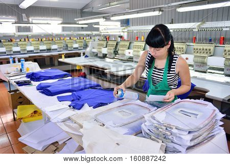 GUKOVO RUSSIA - SEPTEMBER 2016: Workers work in a garment factory. The process of dyeing fabric.
