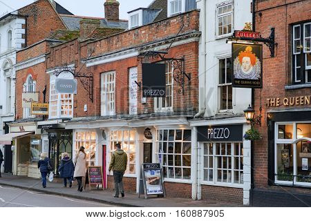 Farnham/UK. 10th December 2016. Shops and retail facilities in a historic central Farnham Street attract day trippers on a cold December day. People are walking along The Borough.