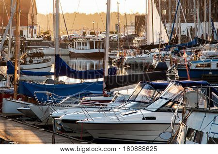 Yachts berthed in yacht harbor at sunset. Klaipeda, Lithuania