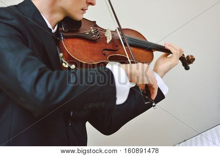 Talented violinist and classical music player solo performance blank copy space on the left