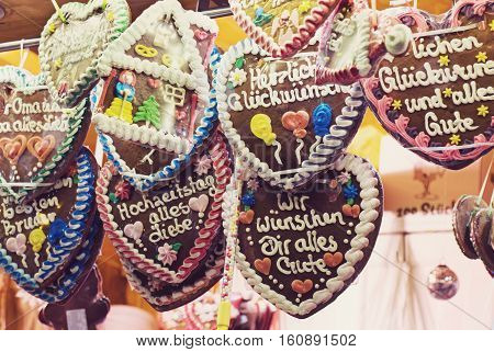 Traditional gingerbread hearts at German Christmas Market. Augsburg Xmas market in Germany.