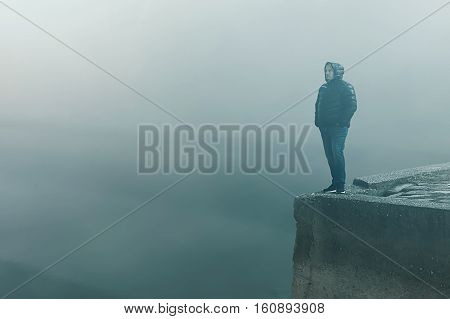 Man Standing Alone On The End Of A Jetty