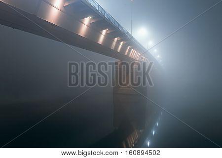 Night Shot Of A Bridge In Thick Fog.