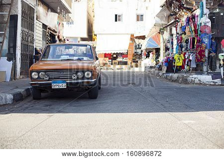 Egypt Sharm el sheikh - august 2016: market bazaar outside front without people, Old Fiat car