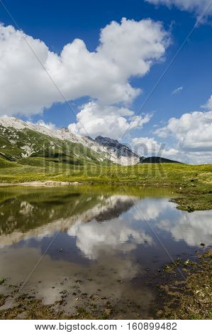 Panoramic view of beautiful landscape with Gran Sasso d'Italia peak at Campo Imperatore plateau in the Apennine Mountains, Abruzzo, Italy poster