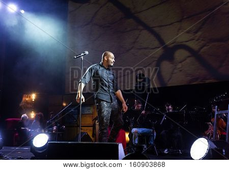CRACOW POLAND - NOV EMBER 6 2016: Symphonica 2 Made in Poland The music of cult of underground rock metal- and punk Polish groups from years 80-these performed by musicians and soloists Filharmonia Futura on stage cinemas Kiev in Cracow. O/p Damian Ukeje
