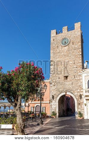 TAORMINA ITALY - AUGUST 20 2016: Taormina's clock tower originally built in the 12th century reconstructed in 1679.