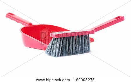 Set of red scoop and brush isolated over white background