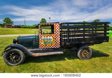 Milton, Ontario, Canada, June 18, 2016, amazing beautiful  car show in the Country Heritage Park, amazing side view of classic vintage straight truck standing in farm field on sunny day