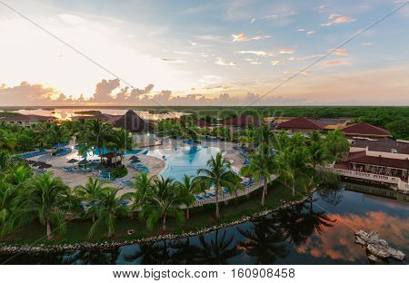 Cayo Coco island, Memories Carib resort, Cuba, June 26, 2016, nice amazing beautiful view of Memories Caribe resort grounds, buildings and tropical garden on early morning sunrise time