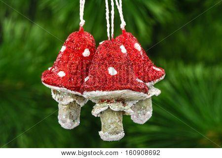 Mushrooms amanita vintage decoration on a Christmas tree background