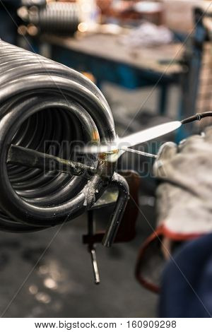 Braze welding process in a metalworking company.
