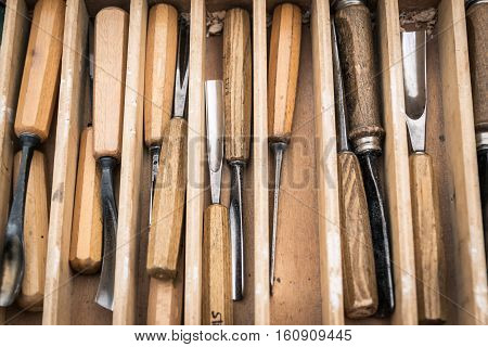 Chisels of various measures to carve wood.