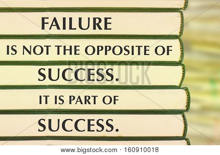 Inspirational motivating quote on stack of books and blur background. Failure is not the opposite of success. it is part of success.