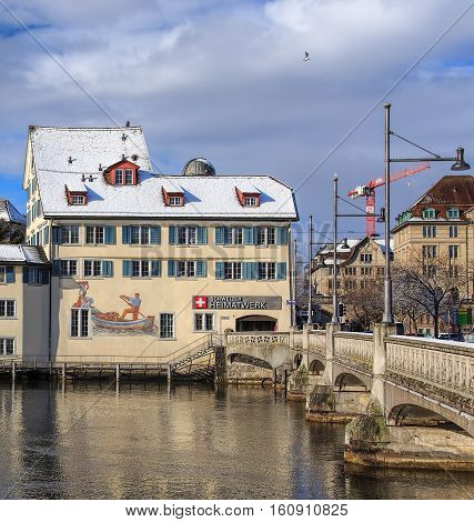Zurich, Switzerland - 1 February, 2015: view along the Rudolf Brun bridge, historic buildings in the background. Zurich is the largest city in Switzerland and the capital of the Swiss Canton of Zurich.