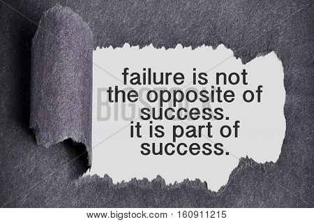 Inspirational Motivating Quote Under Torn Black Sugar Paper. Failure Is Not The Opposite Of Success.