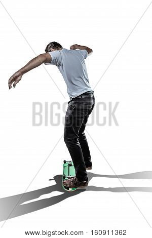 Skateboarder sliding on reversed board isolated on white background