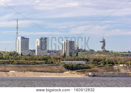 Volga riverbank with a view of monument - The Motherland calls. Volgograd. Russia.