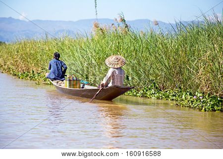 Inthas travel on boat in Inle, Myanmar. Travel by boat is the major transportation mean both local and tourists in Inle lake.