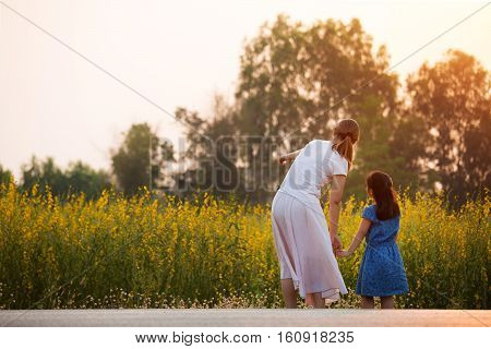 Happy Asian girl and asian woman looking to the flower field, Freedom concept
