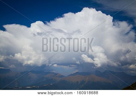 Summer mountain landscape with cumulus cloud