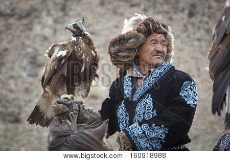 Bayan Ulgii Mongolia October 4th 2015: Eagle hunter with his Altai Golden Eagle