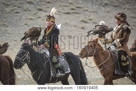 Bayan Ulgii Mongolia October 4th 2015: Eagle huntress riding a horse