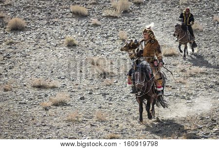 Bayan Ulgii Mongolia October 4th 2015: Eagle hunter riding a horse