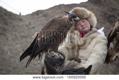 Bayan Ulgii Mongolia October 4th 2015: Eagle huntress with her Altai Golden Eagle
