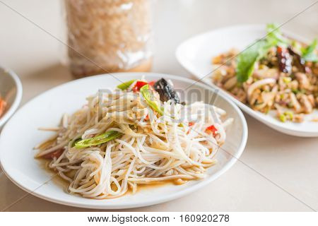Papaya Salad with Vermicelli Salted Crab and Fermented Fish Tum Sua Thai traditional food.
