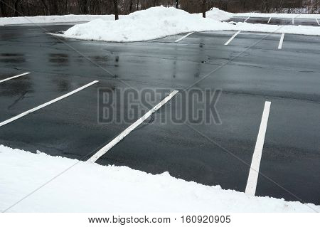 empty parking lot with snow removed in winter