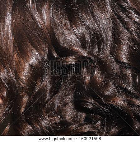 Black hair lock closeup. Beautiful black hair. Black hair background.