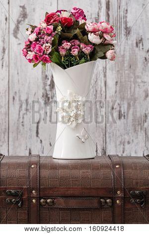 Decorative White Vase With Flowers On White Background